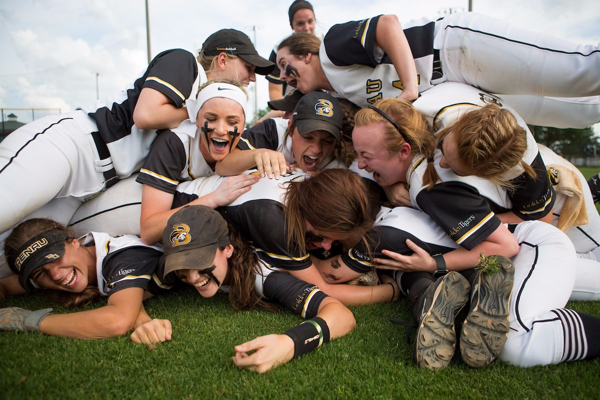 Brenau players pile on on the ground celebrating after winning the championship game of the SSAC conference tournament against Mobile. Brenau won 2-1 in nine inning. Brenau's finished SSAC play, both regular season and the conference tournament 30-0. (AJ Reynolds/Brenau University)