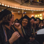 From left, Joan Pack, Corrinna Redford and Kayla Lowry react near the end of the spring commencement ceremony for the Women's College at Brenau University. (AJ Reynolds/Brenau University)