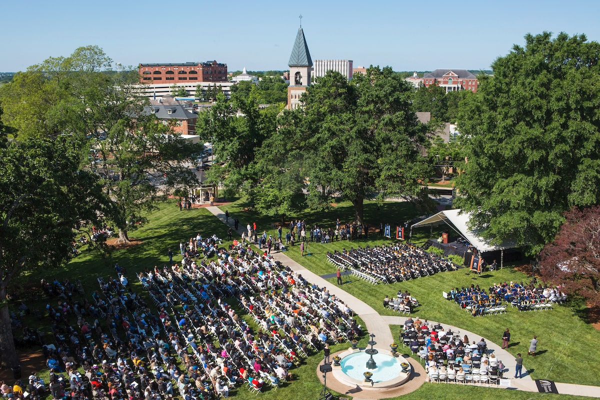 Graduates, family and friends fill Brenau's front campus for the Brenau University Graduate and Undergraduate Commencement ceremony. (AJ Reynolds/Brenau University)