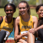 From left to right, Ismaelle Occeus, a senior from Lawrenceville, Ga., Sydney Romine, a freshman from Jasper, Ga., and Cheyenne Wells, a senior from Sandy Springs, Ga., pose for a photo during the NAIA Track & Field Championships in Gulf Shores, Ala. (AJ Reynolds/Brenau University)