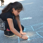 Irais Carlin draws with sidewalk chalk during the RISE Summer Program. RISE, or the Real, Interactive, Summer-Learning Experience, ran from June 5, 2017 through July 14, 2017.