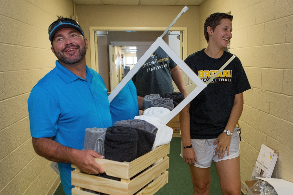 Justin Chapman, father of a residential student, and Keeley Chester, Brenau's assistant basketball coach, laugh while Champman helps move his daughter into Crudup Hall. (AJ Reynolds/Brenau University)