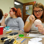 From left to right, Bridgett Tiller, Rachel Christina and Marlee Causey paint bowls for the Georgia Mountain Food Bank''s Annual Empty Bowl Lunch as part of an Artistic/Creative Imagination Honors Seminar. (AJ Reynolds/Brenau University)