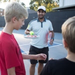 Andre Ferreira gives instructions to Isaiah Rico, left, and Gary Geist during a tennis clinic event celebrating the second annual Tennis Day in Georgia on Tuesday, Oct. 3, 2017. (AJ Reynolds/Brenau University)