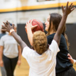 Brenau sophomore basketball player Carmen Garcia-Pitarch Lopez plays a pickup game during a National Fitness Day event at Brenau. Brenau student-athletes spent time with children from the Boys & Girls Club of Lanier practicing various athletic activities. (AJ Reynolds/Brenau University)