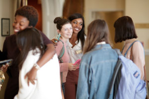 Brenau students gather in the lobby of Pearce Auditorium after GRRRL PowHER Hour, an informal Women's College Convocation. (AJ Reynolds/Brenau University)