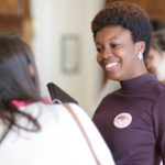 Simone Lewis, SGA President, talks with other students after during GRRRL PowHER Hour, an informal Women's College Convocation. (AJ Reynolds/Brenau University)