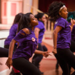 The Tau Sigma Dance Fraternity performs during GRRRL PowHER Hour, an informal Women's College Convocation. (AJ Reynolds/Brenau University)