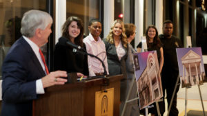 From left to right Brenau health sciences students Bethany Green, Chandy Henson, Savannah Blalock, Ivie Hall and Martis Ferguson, along with Dean of the Ivester College of Health Sciences Gale Starich listen as Brenau President Ed Schrader speaks during an event announcing the naming of the Brenau University Ivester College of Health Sciences. (AJ Reynolds/Brenau University)