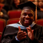 James Davis, educational specialist, cheers after turning his tassel during the Brenau University graduate winter commencement ceremony. (AJ Reynolds/Brenau University)