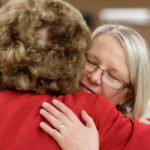 Eva Johnson hugs Sandra Greniewicki during Masters in the Art of Nursing: Healers among us on Thursday, Feb. 15, 2018 at Whalen Auditorium in Brenau East in Featherbone Communiversity in Gainesville. (AJ Reynolds/Brenau University)