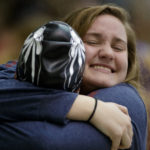 Brenau's Lindsay Dowling a junior from Winston, Ga. hugs Brenau's Ella Kleinschmidt a senior from Hervey Bay, Queensland Australia after the 400-yard freestyle relay during the finals of the NAIA Swimming & Diving National Championship on Saturday, March 3, 2018, in Columbus, Ga. (AJ Reynolds/Brenau University)