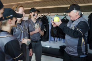 Brenau President Ed Schrader asks softball players to sign a ball to be placed in the Brenau archives to commemorate the first games at Pacolet Milliken Field at the Ernest Ledford Grindle Athletics Park between the Brenau Golden Tigers and Talladega College. (AJ Reynolds/Brenau University)
