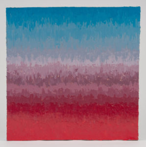 This photo shows an impasto acrylic painting with a rich blue color at the top that blends into a violet and the to a right coral red at the bottom.
