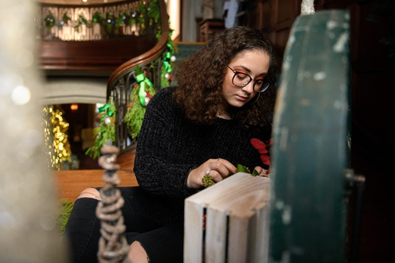 Dominique Wagner works on a portion of the grand staircase at the Callanwolde Fine Arts Center in Atlanta on Tuesday, Nov. 20, 2018. (AJ Reynolds/Brenau University)