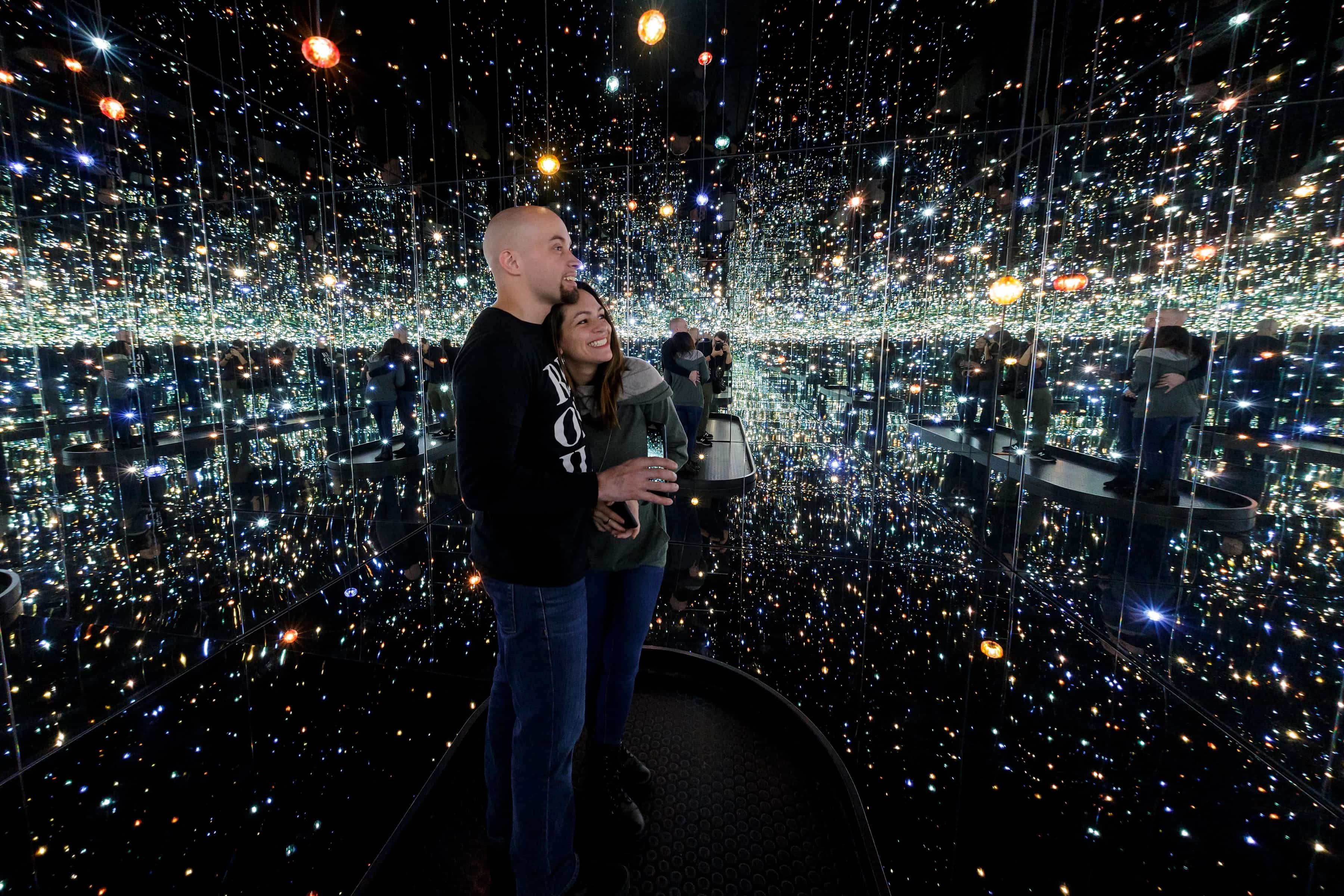 Sarah Iglesias, clinical counseling psychology graduate student, and her husband Brian admire one of the Infinity Mirror Rooms at the High Museum of Art in Atlanta. (AJ Reynolds/Brenau University)