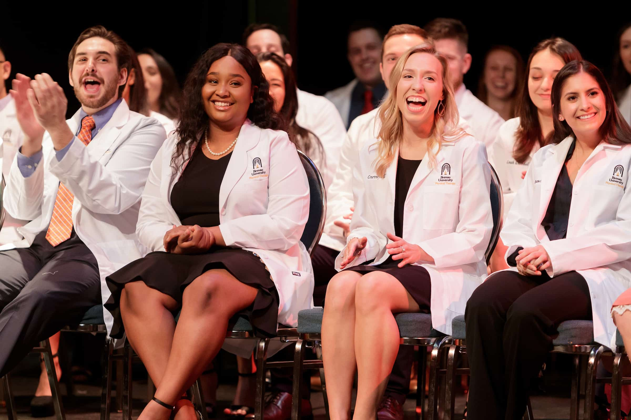 First-year physical therapy students William Byrd, Hannah Brunson, Courtney Bell and Kylie Beauchamp react during the White Coat Ceremony held by the Department of Physical Therapy at Brenau University on Feb. 15. (AJ Reynolds/Brenau University)