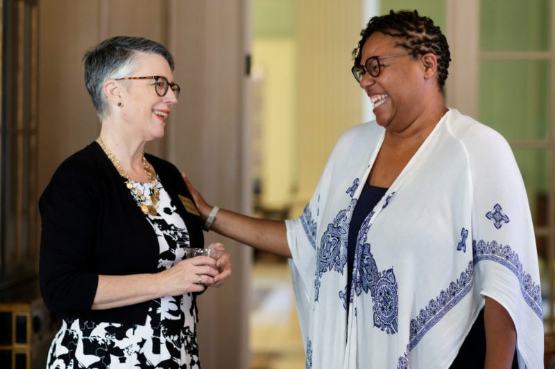 Brenau president Anne Skleder laughs with assistant vice president Crystal Toombs