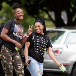 Students smile as they walk on the Brenau University historic Gainesville campus between classes on the first day of the 2019 school year, Monday, Aug. 26. (AJ Reynolds/Brenau University)