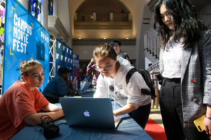 Students sign up for Campus Movie Fest on a laptop
