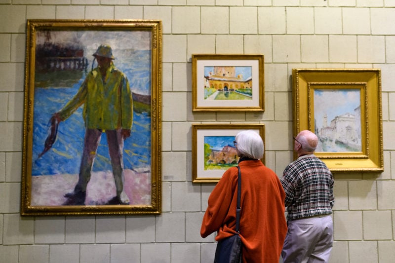 Guests view paintings on display