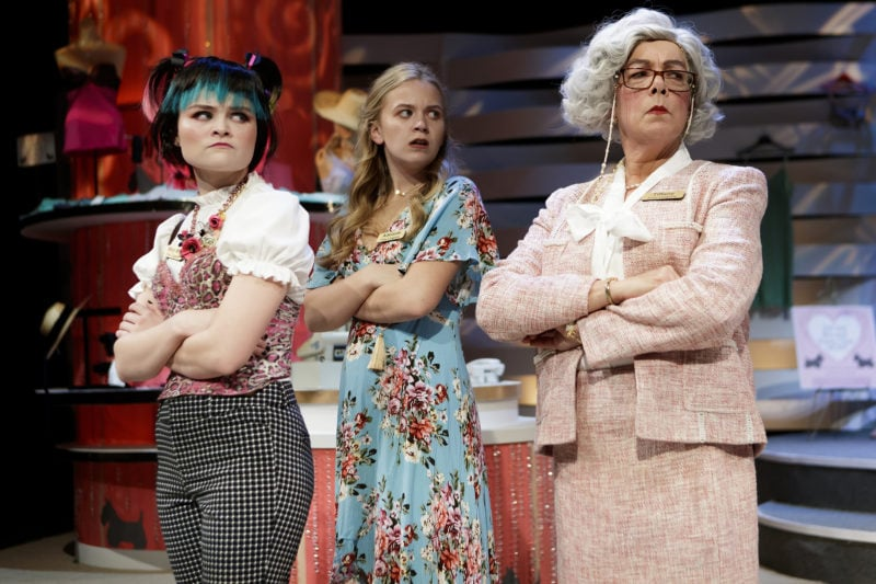 "Three female actresses looking to the right of the photo with varied expressions during the play ""The Bra and Panty Club"" by Gay Hammond"