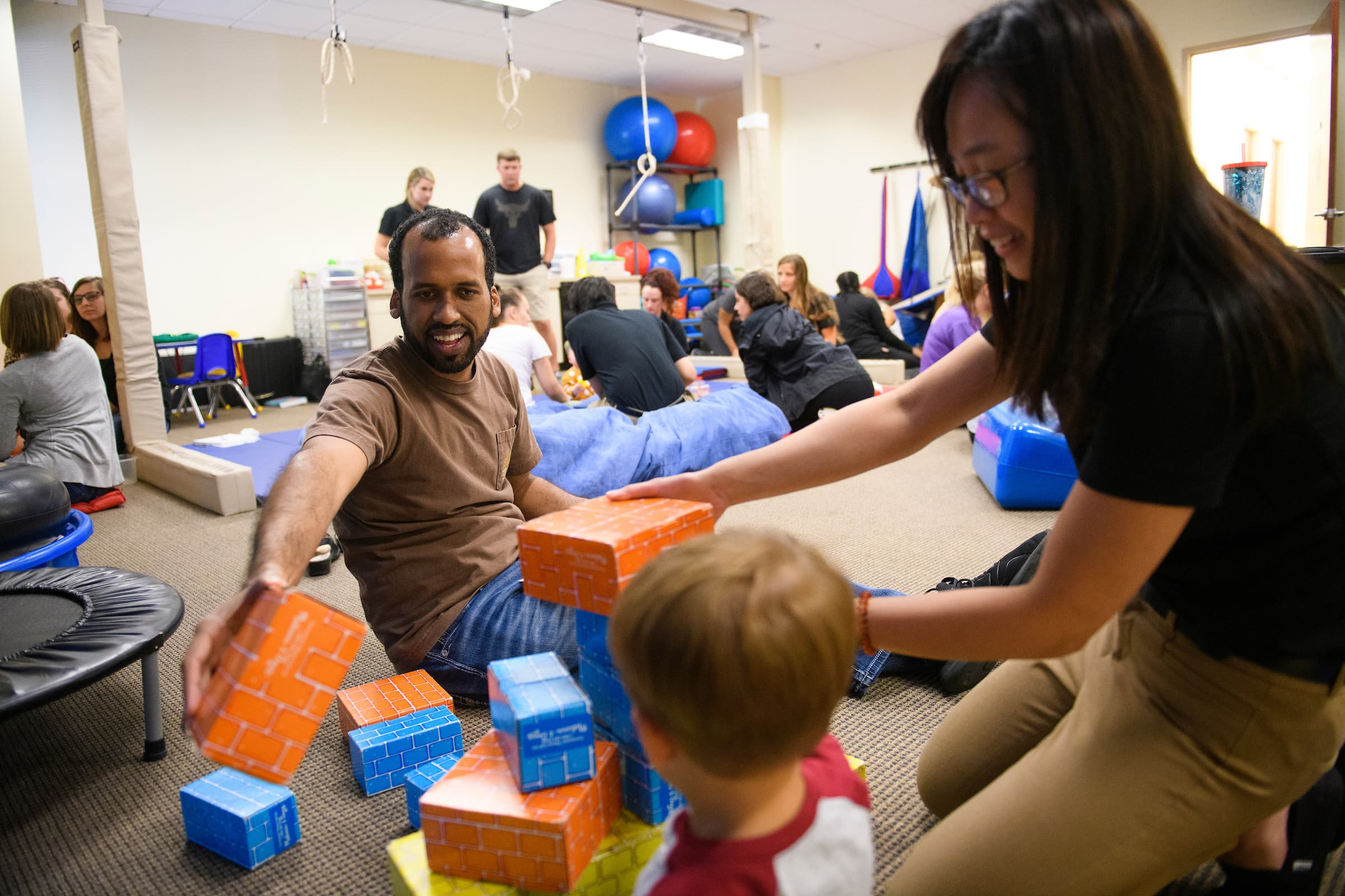 Brenau University occupational therapy students work with a child in a pediatrics lab in 2019. The School of Occupational Therapy was recently ranked No. 42 in the nation by 'U.S. News & World Report.'