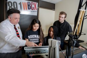 Students working in the radio station WBCX with Professor Jay Andrews (photo credit: AJ Renolds)