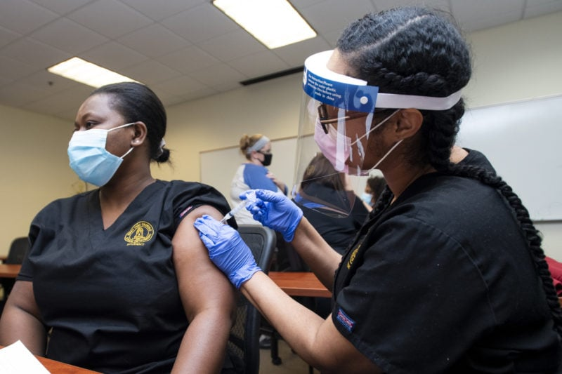 A person receives a COVID-19 vaccination.