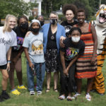 A group of students take a photo with Brenau's mascot, HJ.