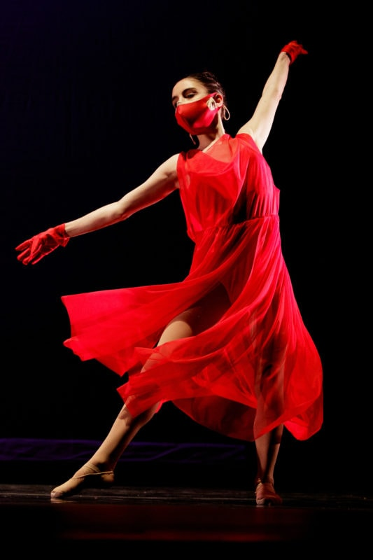 Woman in a red dress dancing